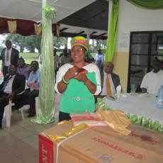 Mme Pauline Welang expressing happiness with a gift
